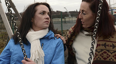 A woman suffering from depression is consoled by her friend in a playground